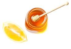 Honey and lemon isolated on a white background. Sweet Honey drip Royalty Free Stock Image
