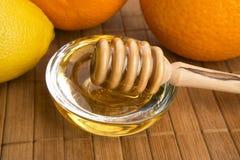 Honey with lemon and orange fruits Stock Image