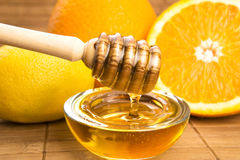 Honey with lemon and orange fruits Stock Photography