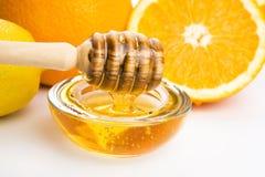 Honey with lemon and orange fruits Stock Photo