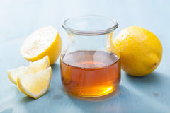 Honey and lemon over blue Stock Photography