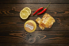 Honey with lemon and spices. On wooden background Stock Photos