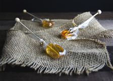 Honey Lemon Sticks on Burlap. Honey lemon spoons are amazing for your hot cup of tea. The honey melts slowly and there`s a stick attached to it to be able to Stock Photos
