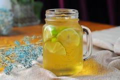Honey lemon tea. A cup of Honey lemon tea on the table Royalty Free Stock Image