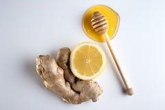 Honey and lemon on a white background Royalty Free Stock Image