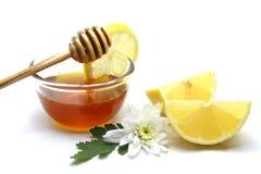 Honey and lemon on white background Royalty Free Stock Images