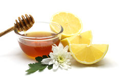 Honey and lemon on white background Royalty Free Stock Photos