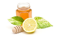 Honey, lemon and wooden drizzler Stock Images