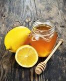 Honey and lemon on a Stock Photos