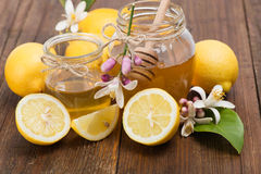 Honey and  lemons Royalty Free Stock Photo