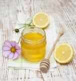 Honey and lemons Royalty Free Stock Image