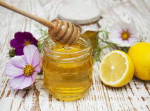 Honey and lemons Royalty Free Stock Photos