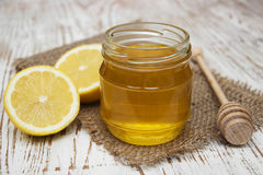Honey and lemons Royalty Free Stock Photography