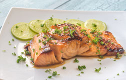 Honey lime salmon on the plate royalty free stock photo