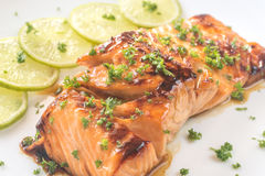 Honey lime salmon on the plate royalty free stock photos