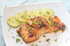 Honey lime salmon on the plate stock images