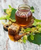 Honey and  linden flowers. Honey  and linden flowers on a board Stock Photo