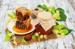 Honey and  linden flowers Stock Photos