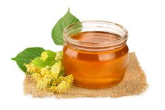 Honey with linden flowers isolated on white background. Honey with linden flowers isolated on white background stock images