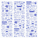 Honey market, bazaar, honey fair Doodle images of bees, flowers, jars, honeycomb, beehive, spot, the keg with lettering Royalty Free Stock Photo
