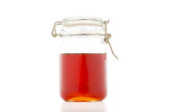 Honey in Mason Jar Isolated on White Background. Royalty Free Stock Images