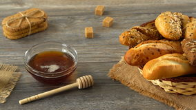 Honey, milk, cookies, and fresh bread on a rustic wooden table. Countryside breakfast. stock footage