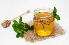 Honey with mint. Honey with  mint on a old white wooden background Stock Photos
