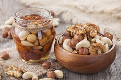 Honey and mixed nuts Stock Images