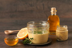 Honey mustard dressing. Homemade honey mustard dressing and ingredients on a table Stock Image