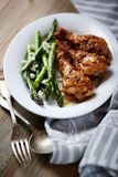 Honey and Mustard Glazed Chicken Legs with Green Asparagus Royalty Free Stock Images