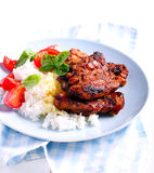 Honey and mustard pork ribs and rice Stock Image