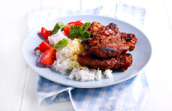 Honey and mustard pork ribs and rice Stock Images