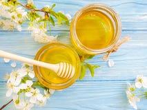 Honey, natural dessert cherry blossoms on wooden background. Honey  natural cherry blossoms on wooden background dessert stock images