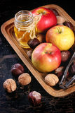 Honey, nuts and apples Stock Photos