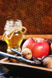 Honey, nuts and apples Stock Image