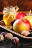 Honey, nuts and apples Stock Photography