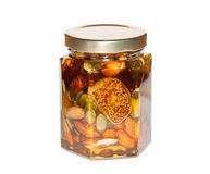 Honey with nuts and dried fruit Royalty Free Stock Photography
