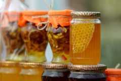 Honey with nuts and fruits Stock Photo