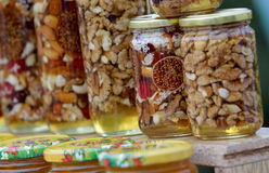 Honey with nuts and fruits Royalty Free Stock Photography