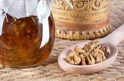 Honey and nuts on rustic table Stock Photo