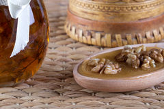 Honey and nuts on rustic table Royalty Free Stock Photos