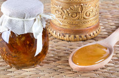Honey and nuts on rustic table Royalty Free Stock Images
