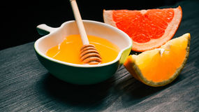 Honey with orange and grapefruit Royalty Free Stock Images