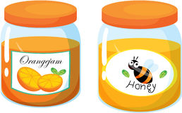 Honey and orange juice jars Royalty Free Stock Photo