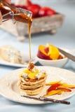 Honey on pancakes royalty free stock photos