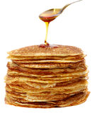 Honey and pancakes. Studio photography tablespoons of honey and pancakes on the white background Royalty Free Stock Images