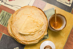 Honey and pancakes Stock Photography