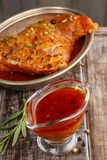 Honey and pepper red marinade in glass gravy boat Royalty Free Stock Photography
