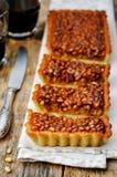 Honey pine nuts tart Stock Image