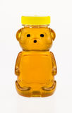 Honey in a plastic container shaped like a bear. Royalty Free Stock Images